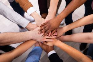 multi-racial stack of hands